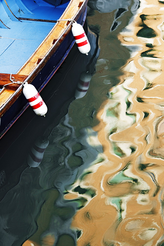 Sunlight and Boat Reflected in Canal, Venice, Italy