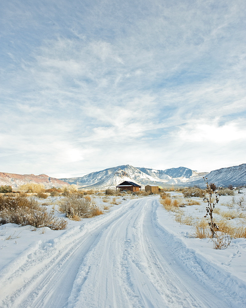 Snowy Trail Leading to a Remote House, Moab, Utah, United States of America
