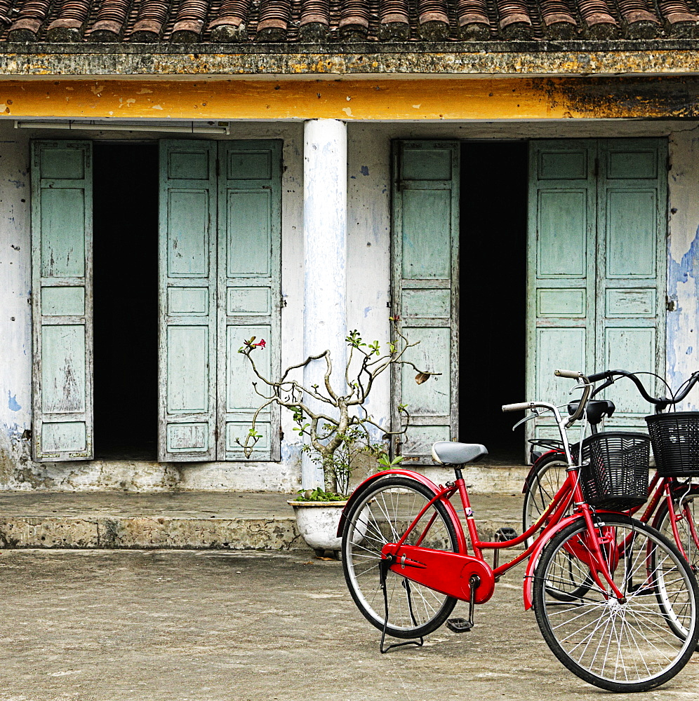 Bicycles parked outside old house, Hoi An, Vietnam