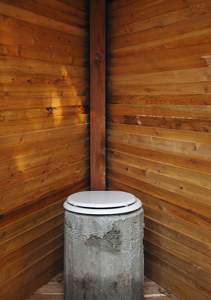Toilet in wooden stall, California, California, USA