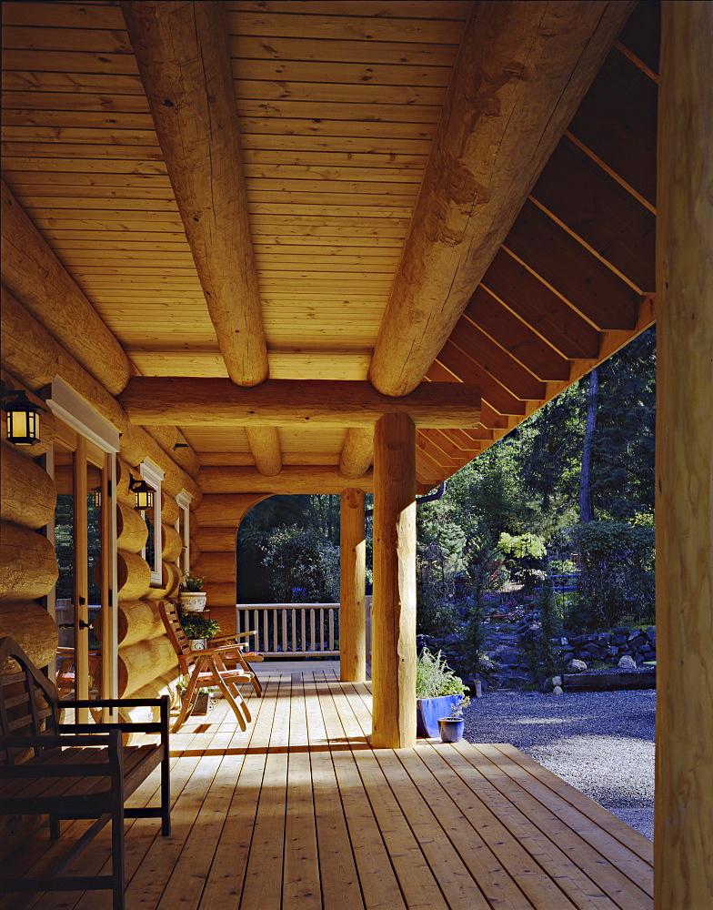 Log cabin porch, Vashon Island, Washington, USA