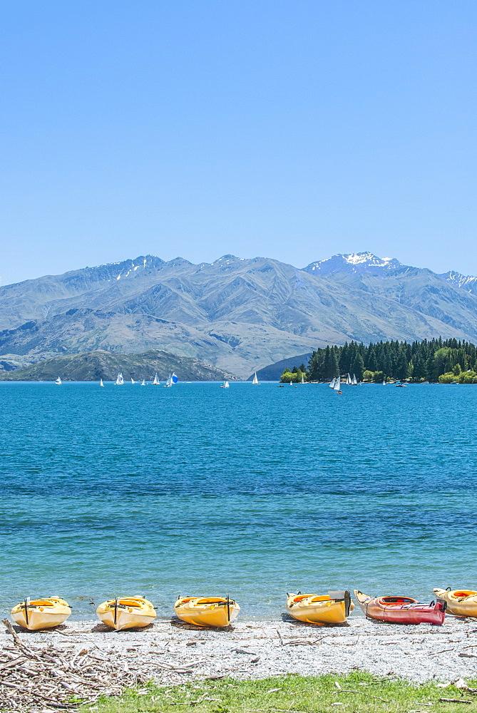 Kayaks docked along beach, Lake Wanaka, Otago, New Zealand, Lake Wanaka, Otago, New Zealand