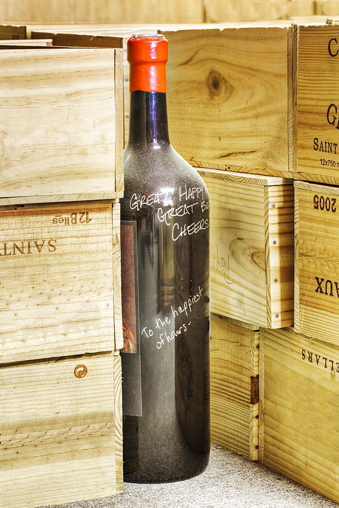 Close up of signed wine bottle in cellar, Tacoma, Washington, USA