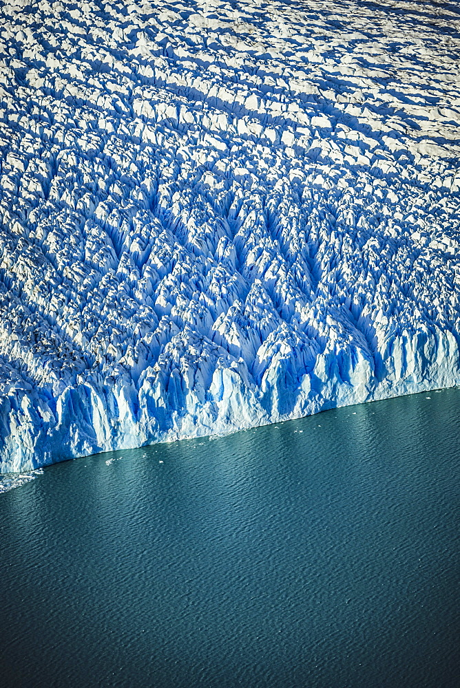 Aerial view of glacier's edge and water