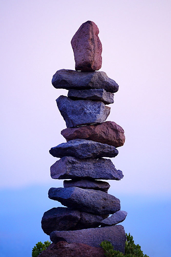 Rocks stacked neatly in rural landscape