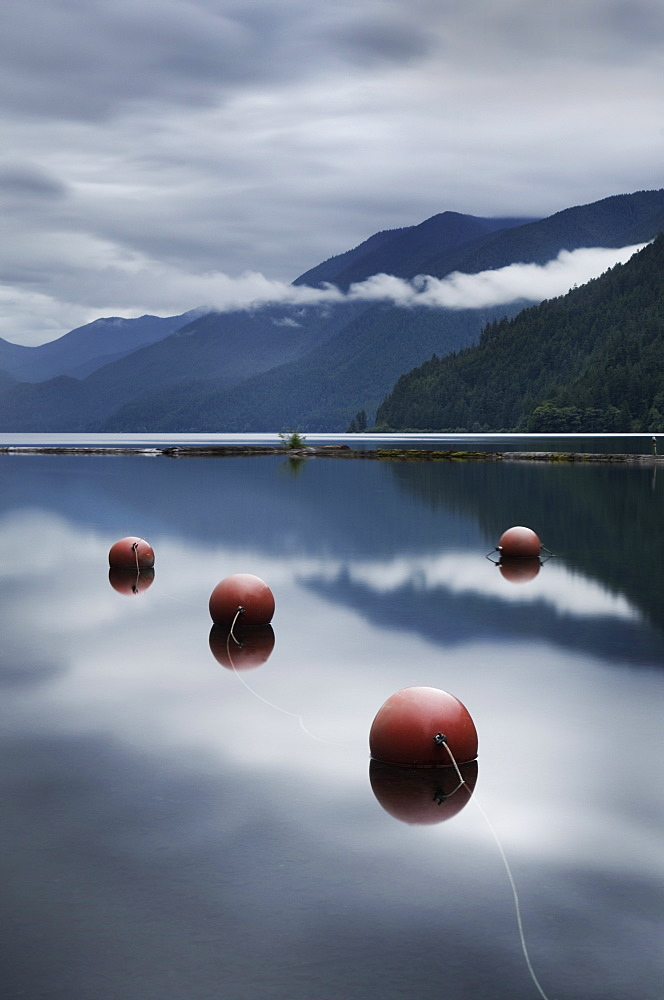 Buoys floating in still remote lake