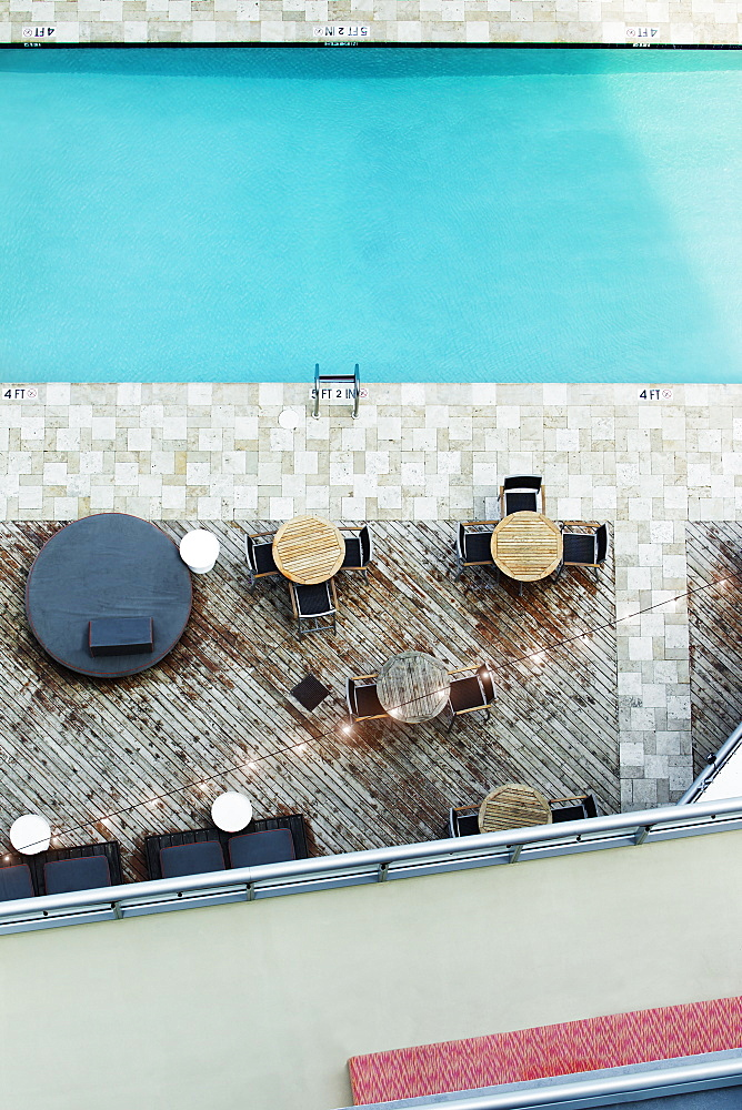 High angle view of tables at hotel swimming pool, Miami, Florida, USA