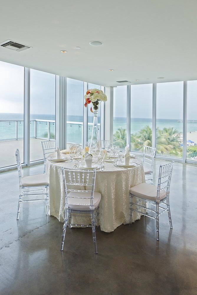 Empty tables in banquet hall, Miami, Florida, USA