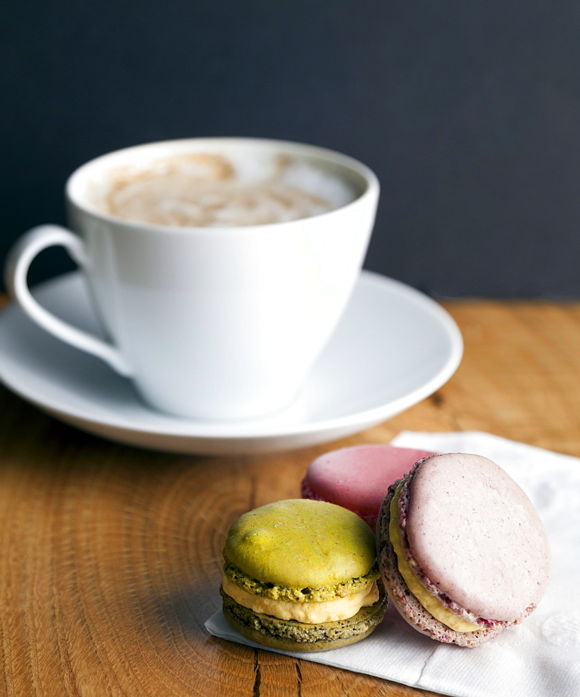 Close up of macaroon cookies and cup of coffee, Seattle, Washington, USA