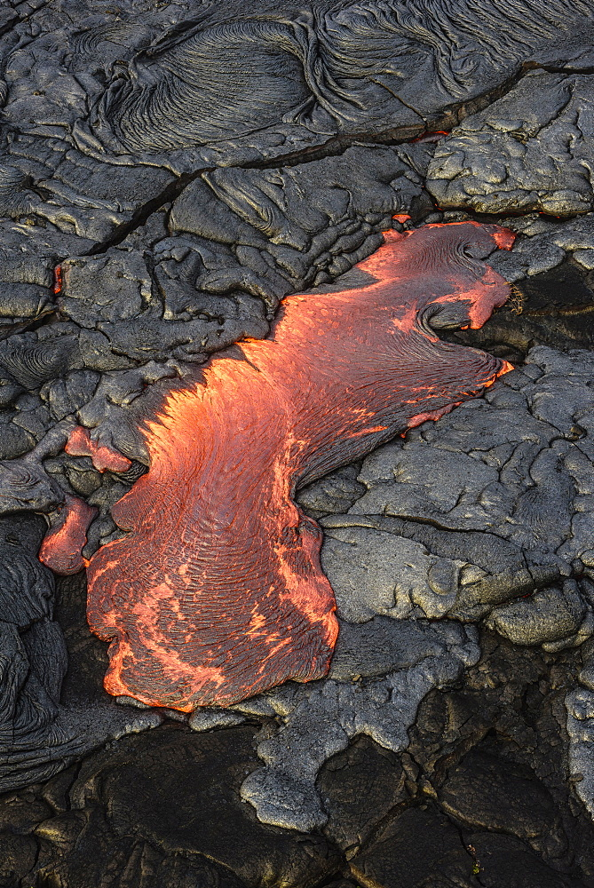 Molten lava glowing near dried lava, Big Island, Hawaii, USA