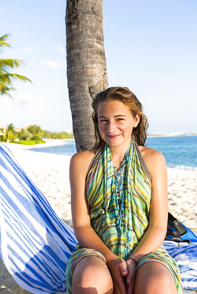 A teenage girl sitting in a beach chair, Grand Cayman, Cayman Islands