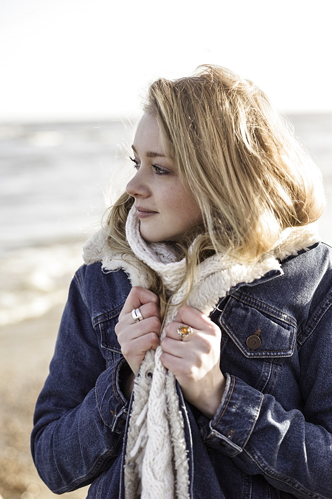 A girl on a beach in winter, Beach, Hampshire, England