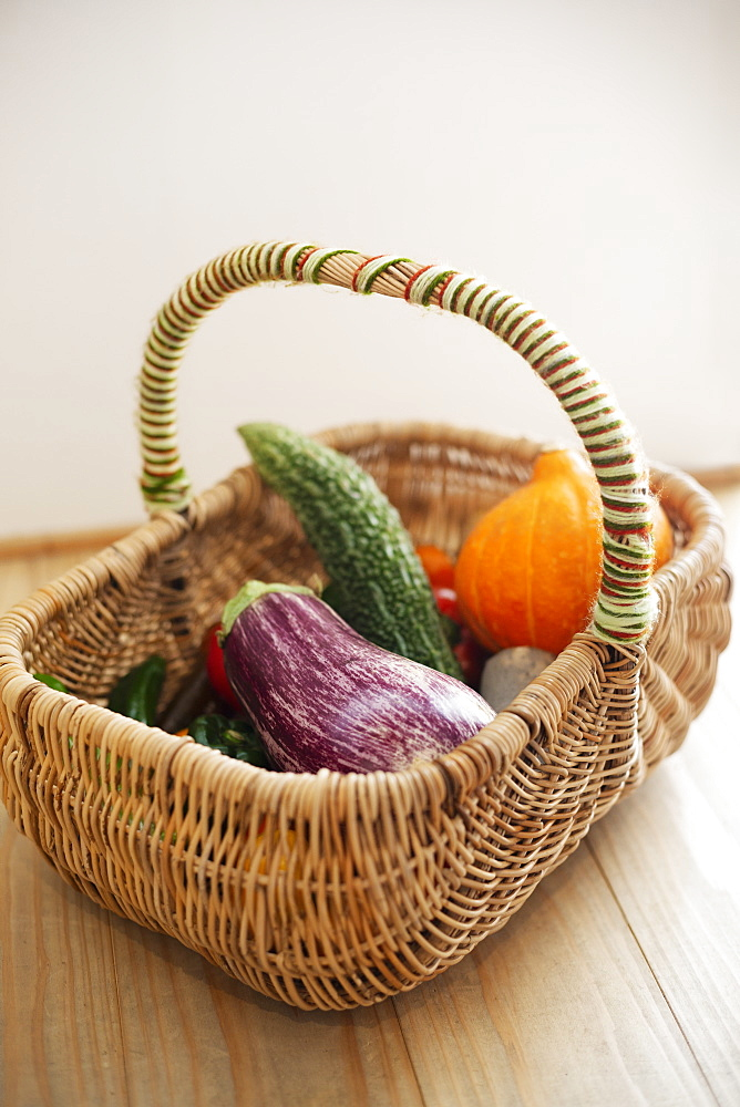 High angle close up of basket with fresh vegetables, Kyushu, Japan