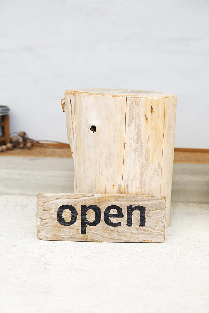Close up of wooden Open sign in a vegetarian cafe, Kyushu, Japan