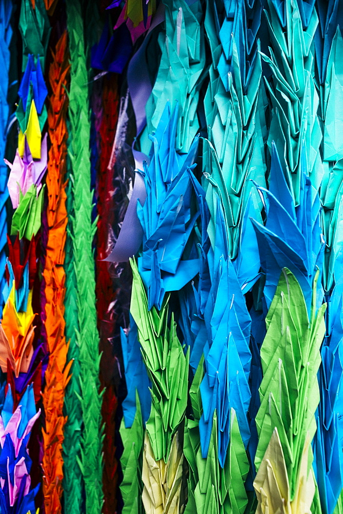 Close up of colourful origami cranes, a symbol of peace, decorating an altar, Kyushu, Japan