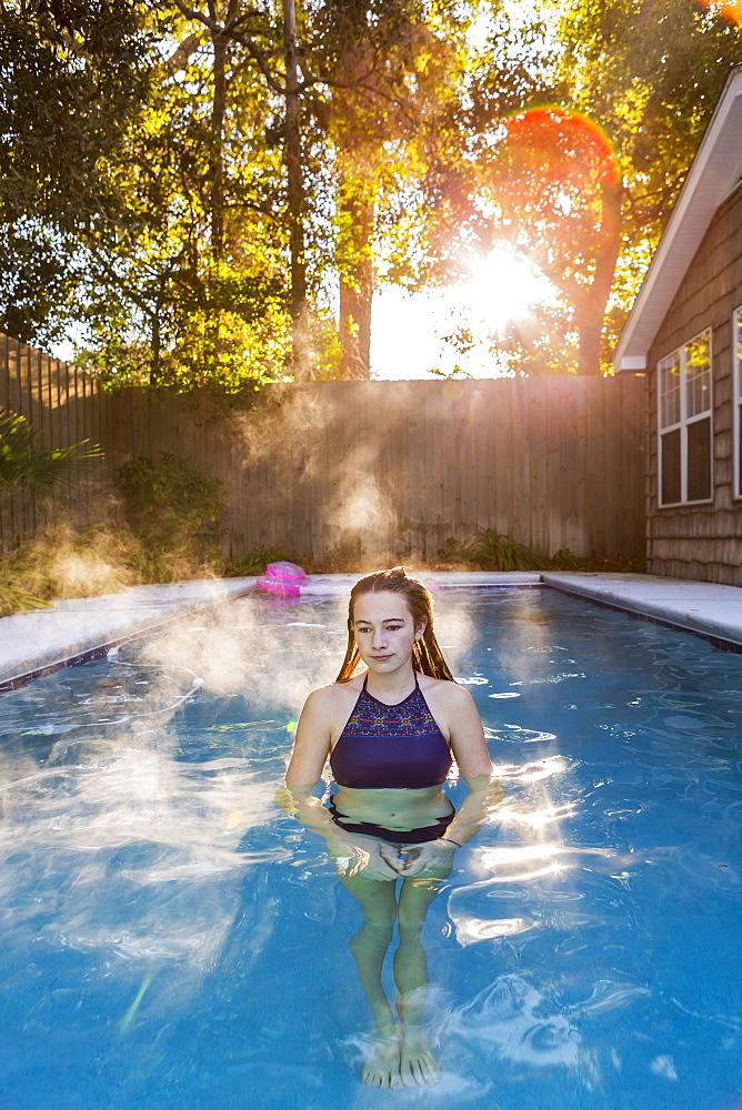A teenage girl swimming in a pool, St Simon's Island, Georgia, United States - 1174-7806