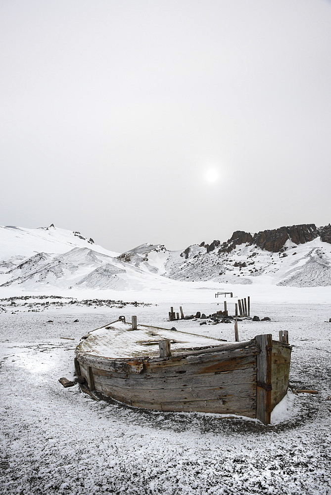 A wooden boat hull beached on Deception island, a former whaling station, Deception Island, South Shetland Islands, Antarctica