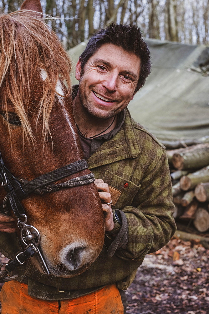 Portrait of a logger with one of his work horses, Devon, United Kingdom - 1174-8238