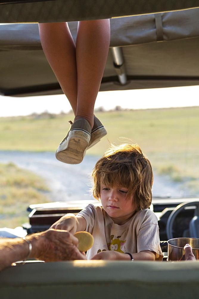 5 year old boy in safari vehicle, Kalahari Desert, Makgadikgadi Salt Pans, Botswana