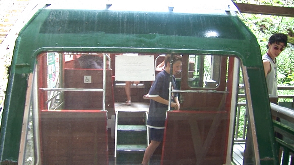 Tourists get off water-balanced cliff railway. Centre for Alternative Technology. Machynlleth. Powys. Wales