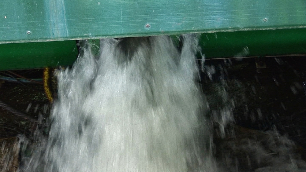 Water from water-balanced cliff railway at bottom of track. Centre for Alternative Technology. Machynlleth. Powys. Wales