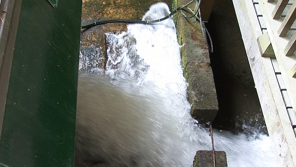 Water flooding out of water-balanced cliff railway. Centre for Alternative Technology. Machynlleth. Powys. Wales