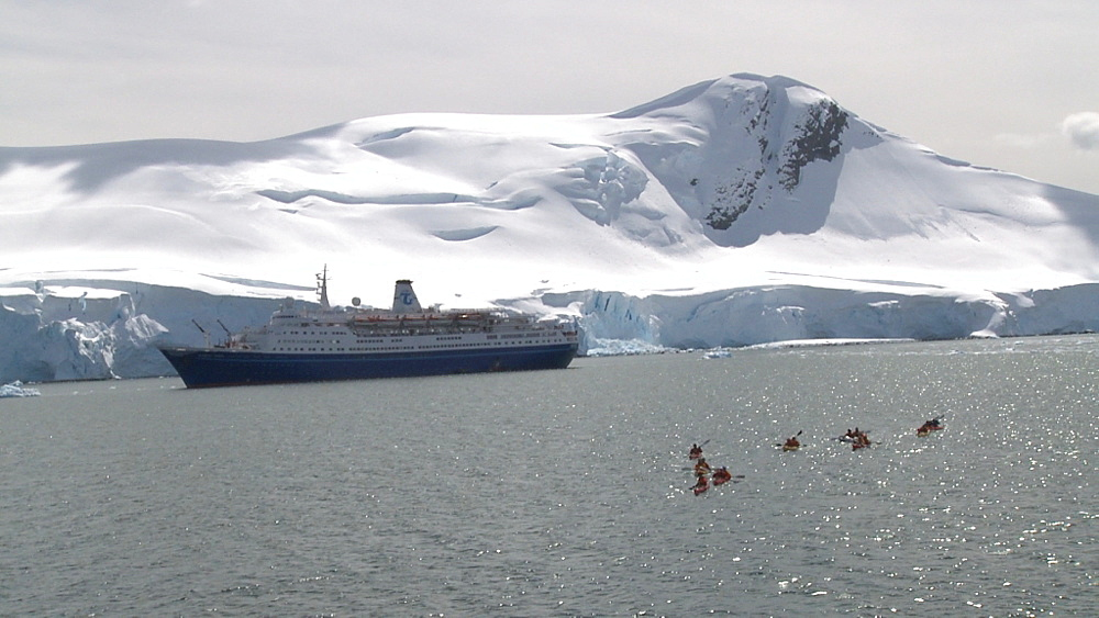 kayakers, ship Marco Polo behind, typical Antarctic scenery. Paradise Bay  - 1034-910