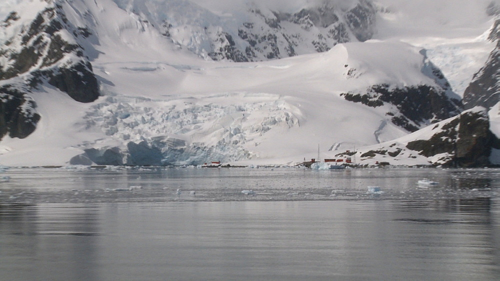 Argentinian Antarctic station from boat, pull out to wide. Almirante Brown. Paradise Bay - 1034-914