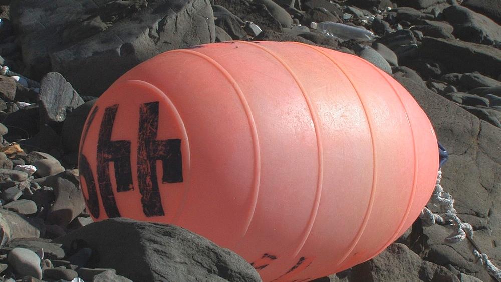 Discarded buoy on pebble beach. Aleutian Islands, Bering Strait - 959-10