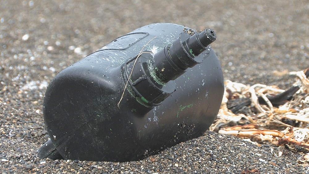 Discarded plastic on pebble beach. Aleutian Islands, Bering Strait - 959-11
