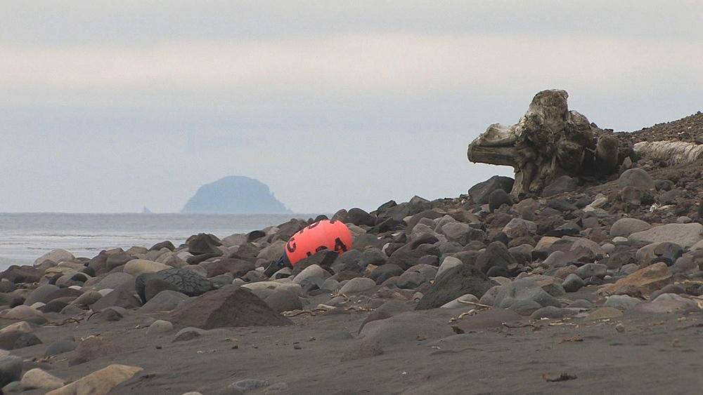 Discarded buoy on pebble beach. Aleutian Islands, Bering Strait - 959-12