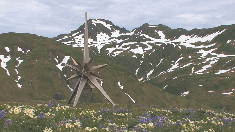 Mountains with flowers and Japanese Peace Monument in foreground.  Attu Island. Aleutian Islands. Alaska