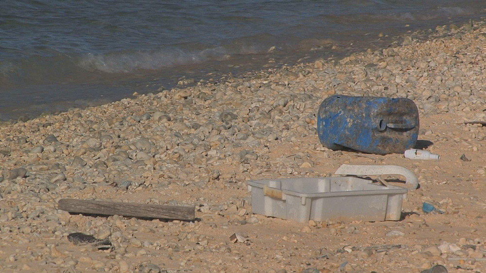 Plastic rubbish accumulated at strandline on beach. Conservation story - rubbish. Midway Island. Pacific - 959-3