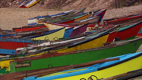 Colourful fishing boats on sand, Mozambique