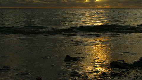 Scenic, waves at tide line, Sunset. Aldabra, Indian Ocean