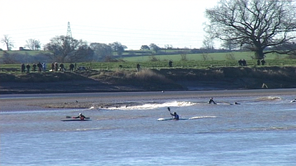 Severn Bore with surfers and kayakers. River Severn. UK - 1031-101