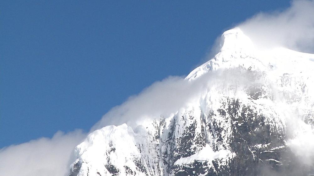 Antarctic mountain with clouds. Jougla Point, Antarctic peninsula