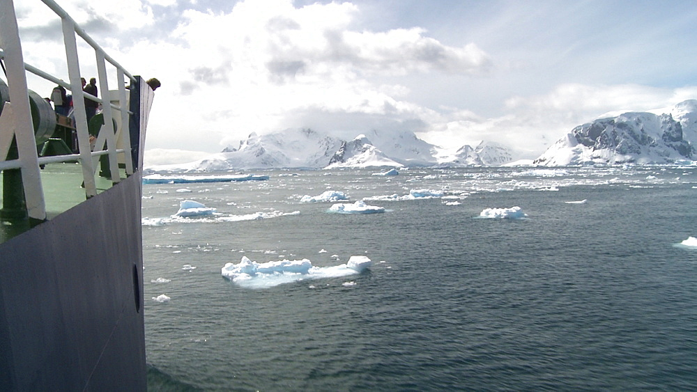 Scenic track with prow of ice breaker through sea and ice. Anvoord Bay, approaching Neko Harbour, Antarctic peninsula