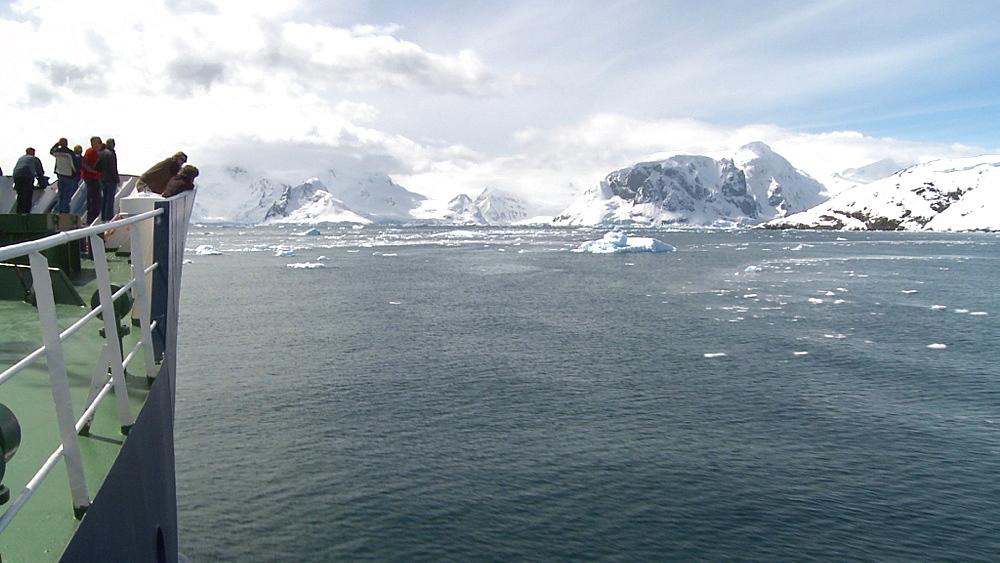 Tourists on icebreaker. Antarctic scenery. Anvoord Bay, Neko Harbour
