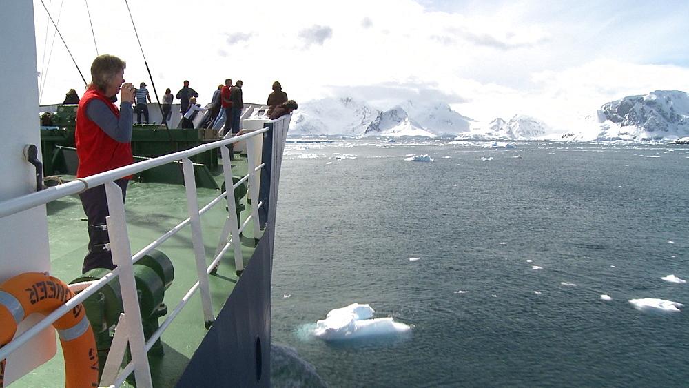 Tourists on icebreaker. Photographing Antarctic scenery. Anvoord Bay, Neko Harbour