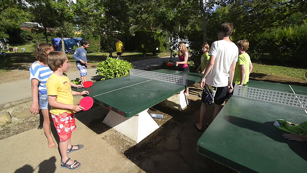 Children playing Round the World table tennis in campsite, Goulien, Brittany, France, Europe - 1108-58