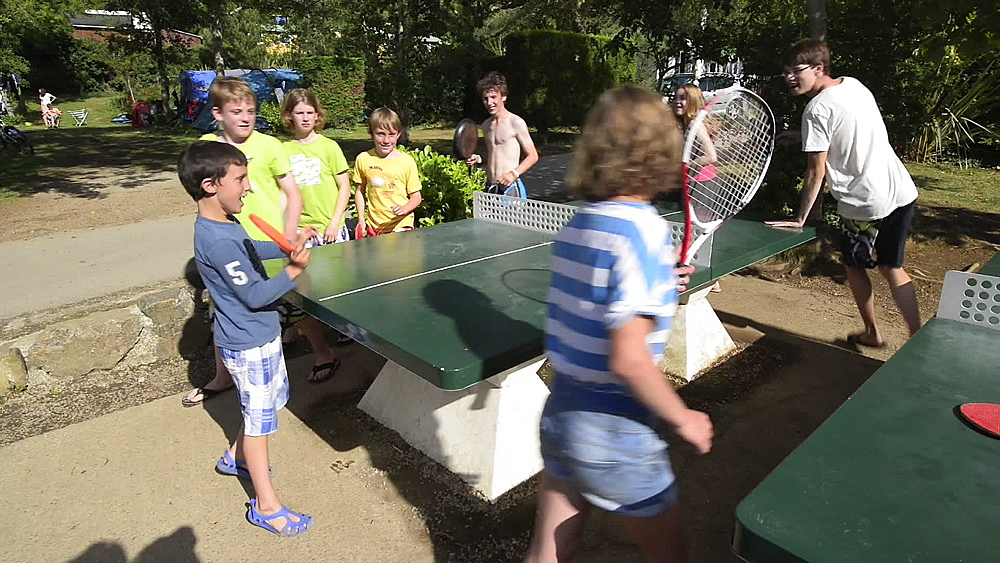 Children playing Round the World table tennis in campsite, Goulien, Brittany, France, Europe - 1108-59
