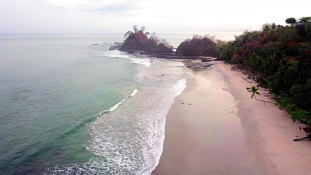Drone shot of Playa Blanca Beach at sunrise, Punta Leona, Pacific Coast of Costa Rica, Central America - 1109-3891