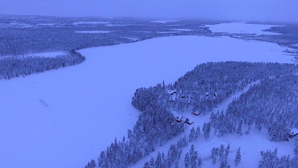 View by drone of Torassieppi Lake (Toras-Sieppi Jarvi) frozen and snow covered in winter, Finnish Lapland, Finland, Europe
