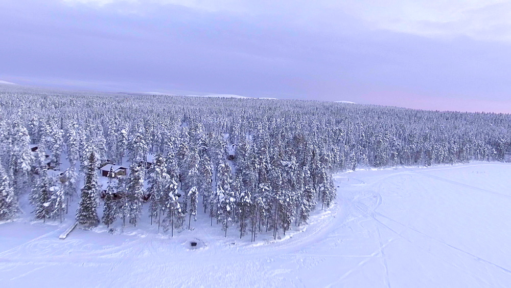 View by drone of Torassieppi Lake covered in snow in winter, Finnish Lapland, Finland, Europe