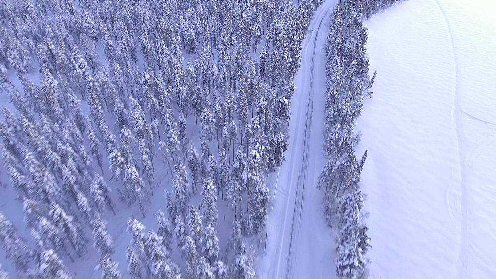View by drone of snow covered road in winter, Torassieppi Lake, Finnish Lapland, Finland, Europe