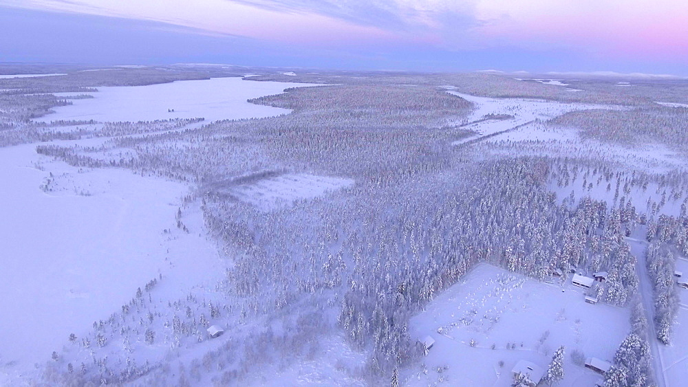 View by drone of snow covered river mouth in winter, Torassieppi Lake, Finnish Lapland, Finland, Europe