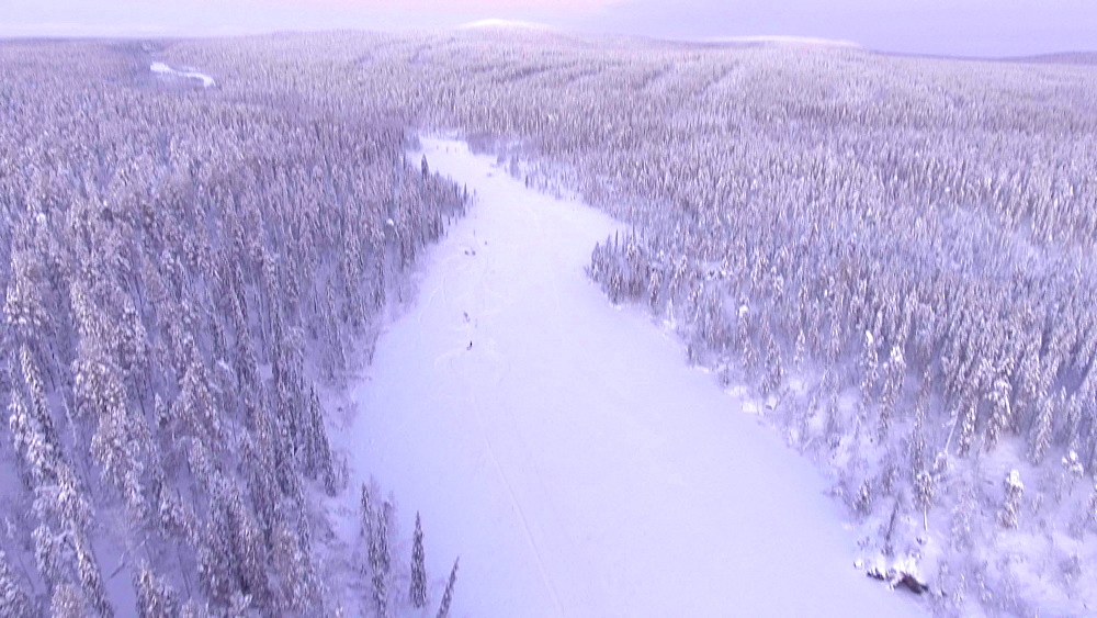 View by drone of snow covered river and winter landscape, Akaslompolo, Finnish Lapland, Finland, Europe