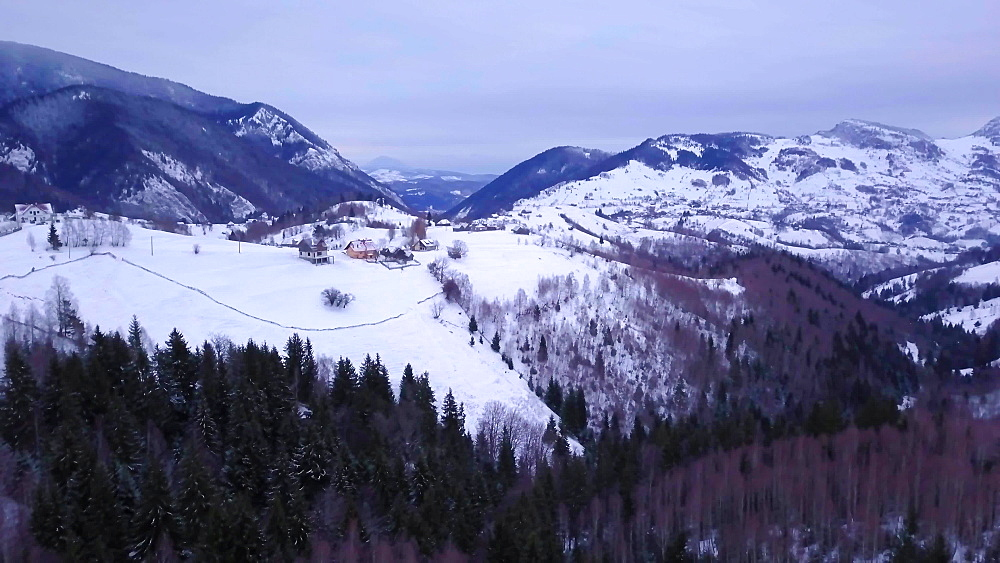 View by drone of snowy winter landscape in the Carpathian Mountains near Bran Castle, Transylvania, Romania, Europe