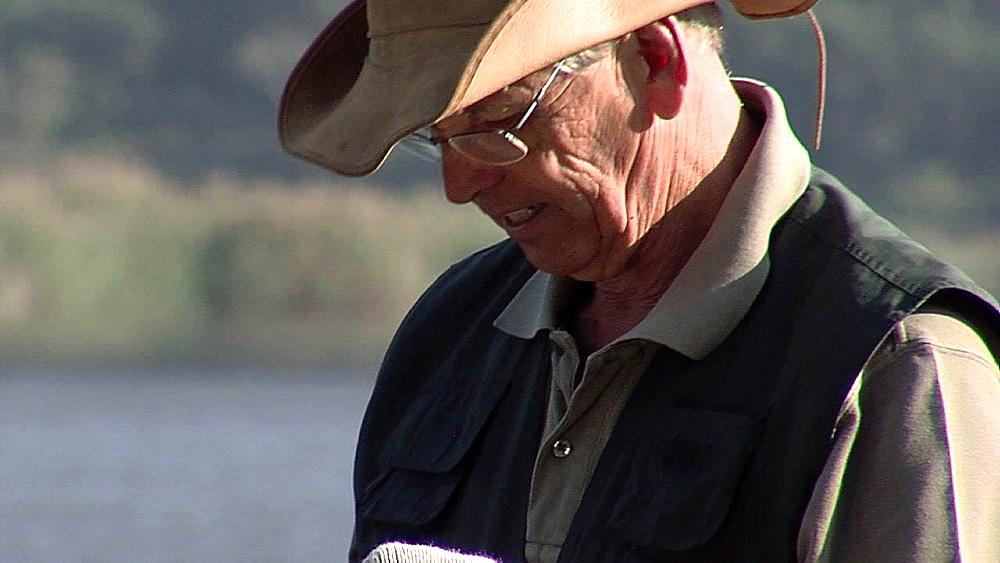 Gentleman wearing a green jerkin near water - 1114-1497
